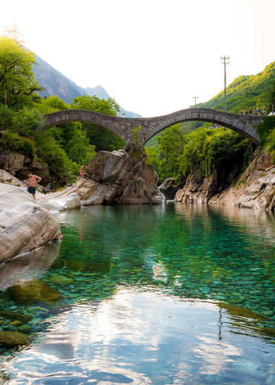 Beauty In Nature Bridge Bridge - Man Made Structure Day Mountain Nature No People Non-urban Scene Outdoors Plant Reflection River Rock Rock - Object Scenics - Nature Sky Tranquil Scene Tranquility Tree Water Waterfront