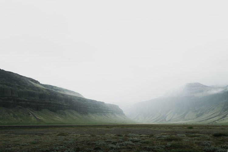 Scenic view of mountains during foggy weather