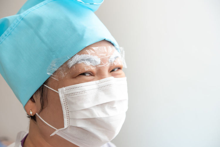 Close-up portrait of doctor wearing mask at hospital