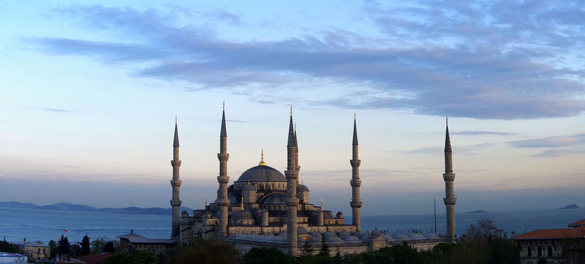 Blue mosque against sky during sunset