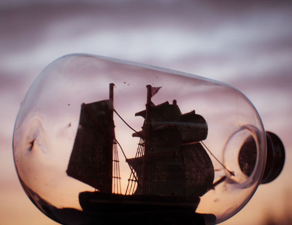 Blurred Background Close-up Danish Design Miniature Sailboat In Sunset Seafarerslife Ship In A Bottle Sky And Clouds DSLR APS-C