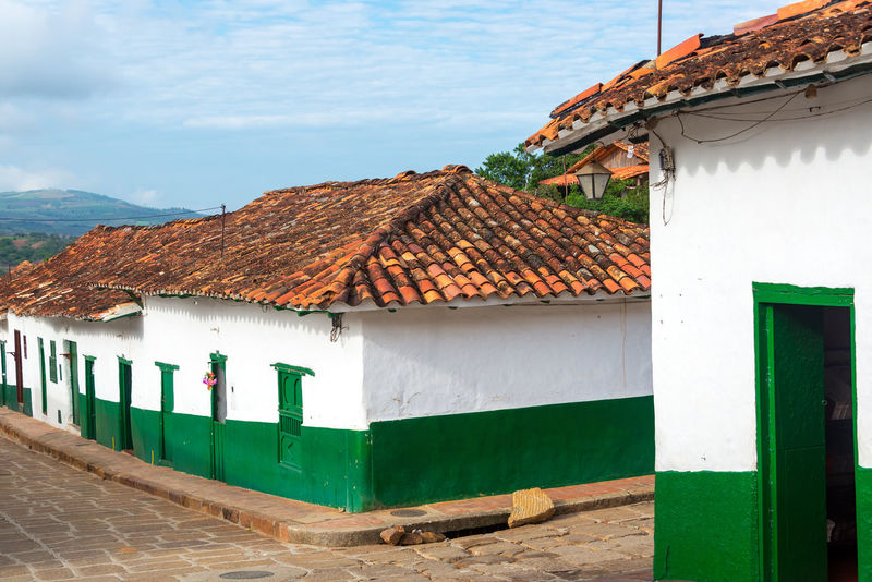 Green and white colonial street corner in Barichara, Colombia Architecture Barichara Building Colombia Colonial Culture Exterior Faith Façade Historic Historical House Landmark Old Sandstone Santander Spanish Stone Street Tourism Town Travel Typical Vacation White