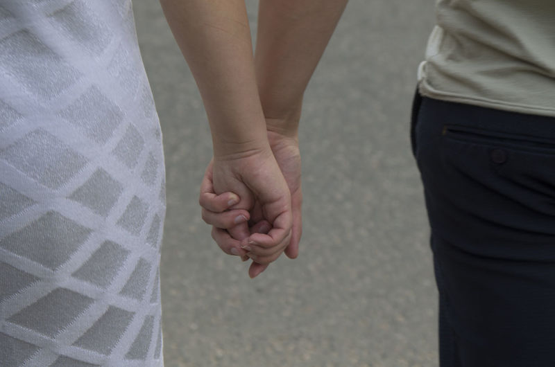man and woman go holding hands Valentine's Day  Hands Husband Wife Army Copy Space Go Arm Handshaking Male Together Adult Close-up Hand Holding Holding Hands Lifestyles Love Men Outdoors Pair People Real People Shake Hands Shaking Hands Two People Women