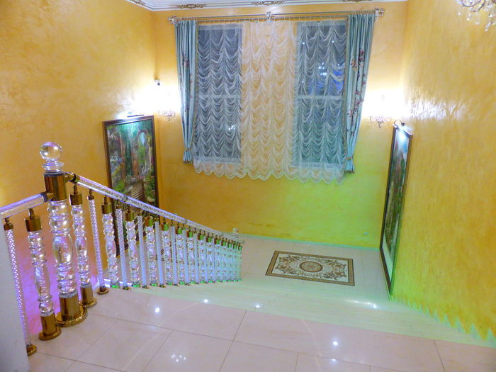 Illuminated staircase of building at home