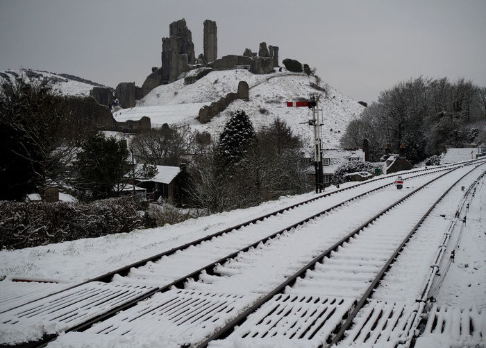 Corfe Casle Castles Railroad Track Snow Tracks Architecture Building Exterior Built Structure Castle Ruin Castle Ruins Castle Tower Castle View  Castle Walls Cold Temperature Corfe Corfe Castle Corfe Town Corfe Village Corfecastle No People Rail Transportation Railroad Track Scenics Snow Snow Covered Track Winter