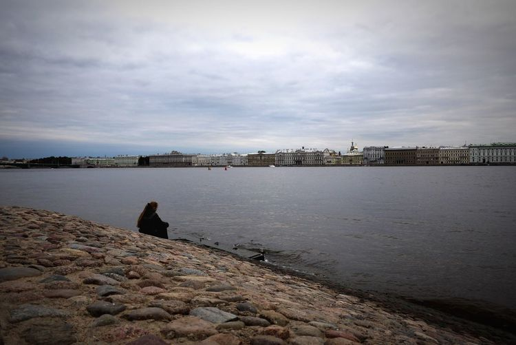 Cloud - Sky Sitting Cloudy Pe People People Of EyeEm People And Places People Photography Sitting Outside Woman Women Of EyeEm Riverside River View Built Structure Buildings & Sky