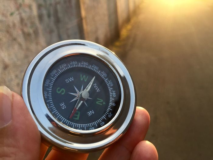 Compass Human Hand Hand Human Body Part One Person Holding Unrecognizable Person Focus On Foreground Close-up Human Finger Navigational Compass Direction Exploration Guidance Number Outdoors Searching Day Body Part