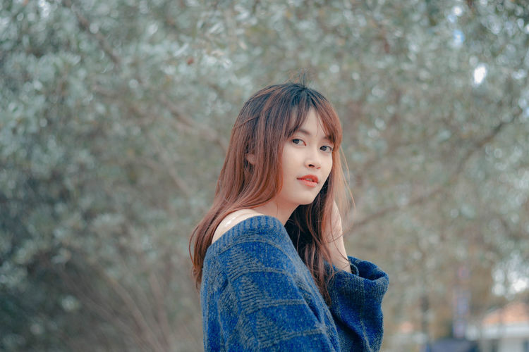 Beautiful woman in winter One Person Portrait Real People Hairstyle Young Adult Young Women Hair Long Hair Focus On Foreground Women Lifestyles Leisure Activity Beautiful Woman Casual Clothing Beauty Standing Looking At Camera Headshot Tree Contemplation Bangs Outdoors Warm Clothing
