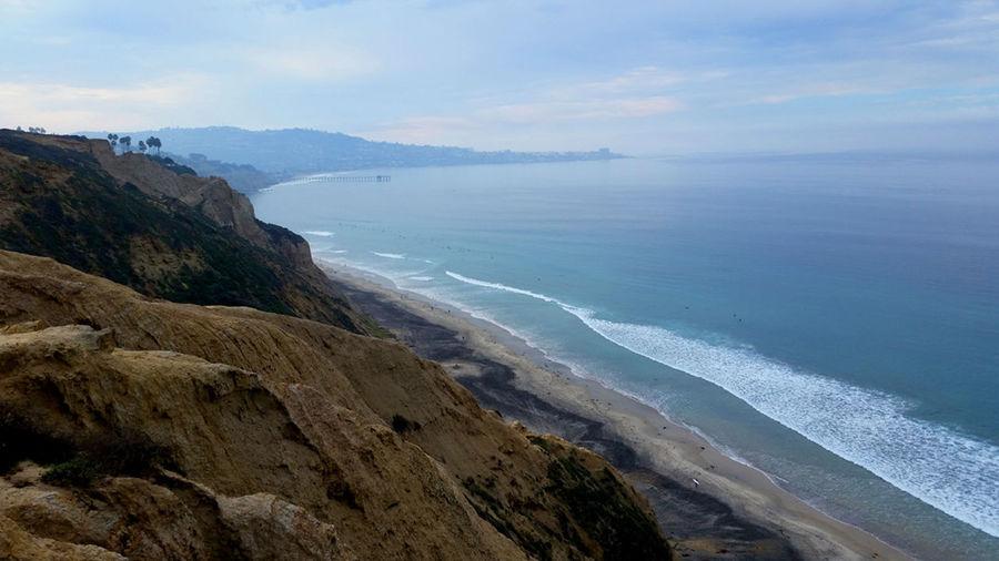 Beach Coastline Horizon Over Water Ocean Outdoors Rock Sand Scenics Sea Seascape Shore Surf Tranquil Scene Water Wave
