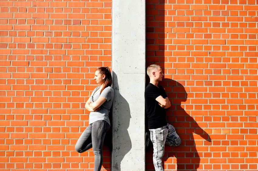 Urban lifestyle Brick Wall Two People Togetherness Standing Casual Clothing Young Adult Friendship Outdoors Urban Style Urban Photography Urban Kids Young Women Love Lifestyles Relaxation Leisure Activity Couple - Relationship Abstract Photography The Graphic City