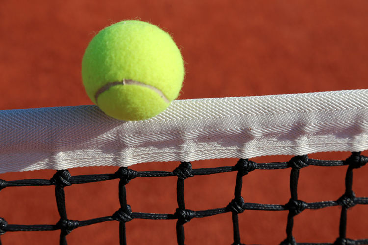Close-up of yellow ball on the net