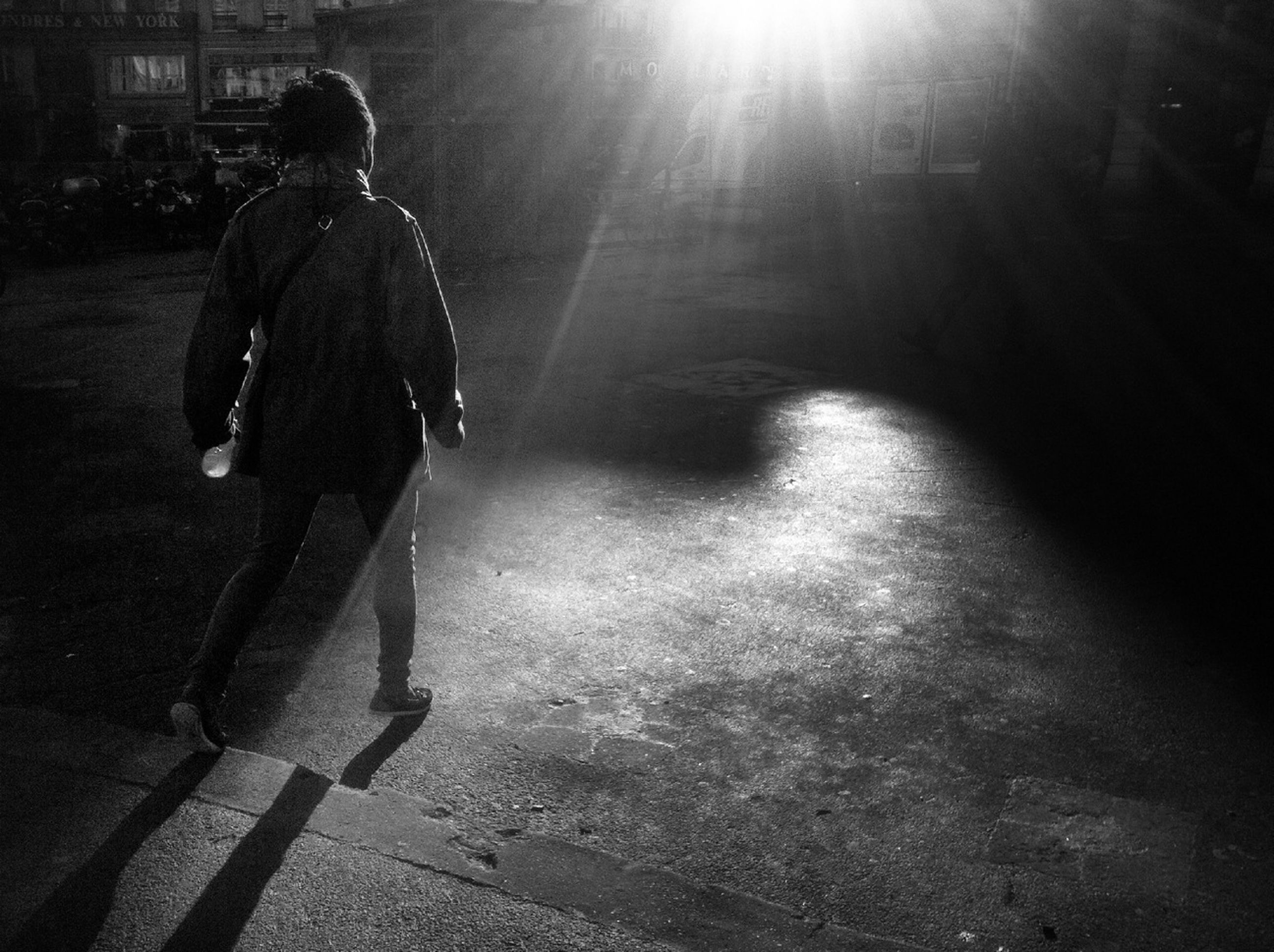 walking, lifestyles, full length, leisure activity, rear view, sunlight, shadow, men, person, standing, street, silhouette, sunbeam, casual clothing, road, outdoors, sunny, day