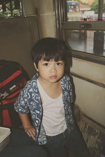 Portrait of boy sitting in train