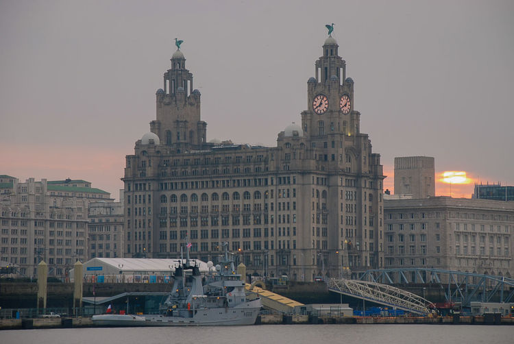 The iconic liver building on the waterfront next to the river mersey in liverpool. uk