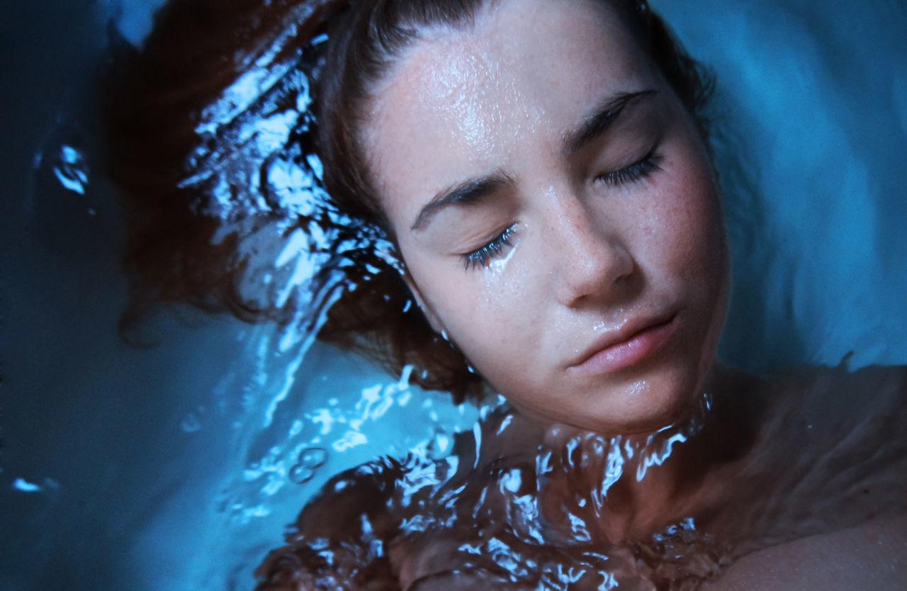 real people, one person, water, close-up, lifestyles, young adult, young women, headshot, indoors, day