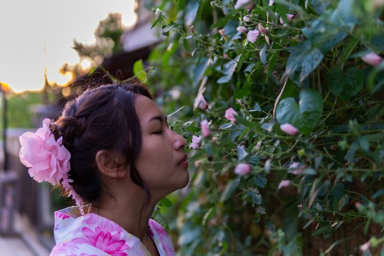 Pink themes. Japan Japanese Culture Japanese Style Portrait Of A Woman Travel YUKATA Beautiful Woman Beauty In Nature Close-up Enchanted  Flower Flowering Plant Freshness Hairstyle Headshot Kimono Leisure Activity Lifestyles Nature One Person Pink Color Plant Portrait Smelling Women