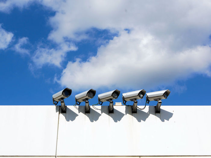Camera Array Blue Sky Cctv Clean Cloud - Sky Control Day Group Low Angle View No People Outdoors Sky Spy Sunlight Surveillance White Technology I Can't Live Without