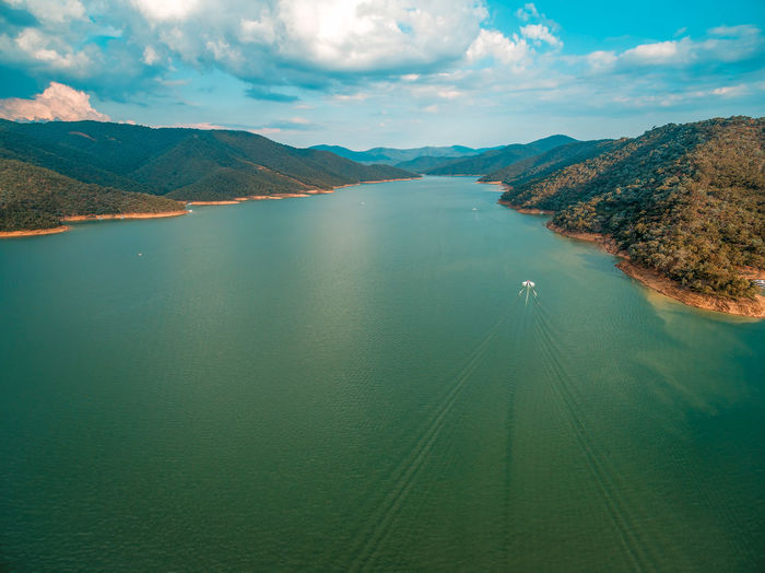 Aerial landscape of boat sailing in Lake Eildon at sunset in Australia Australia Australian Landscape Beautiful Breathtaking Drone  Panorama Panoramic Scenic Aerial View Drone Photography Eildon Lake Landscape Scenics Sunset