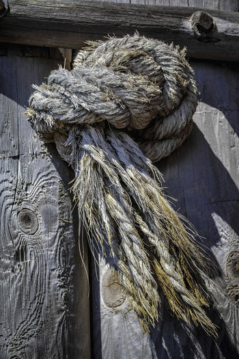 Close-up Day Detail Focus On Foreground No People Old Outdoors Pattern Plank Rope Still Life Strength Textured  Tied Knot Twisted Water Wood - Material The Still Life Photographer - 2018 EyeEm Awards