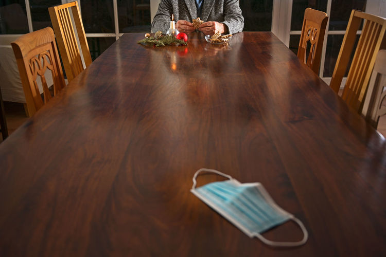 High angle view of person on table at home