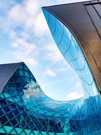 Welcome to Emporia. Entrance Blue Grand Grandiose Parabolic Line City Modern Skyscraper Steel Futuristic Sky Architecture Building Exterior Built Structure