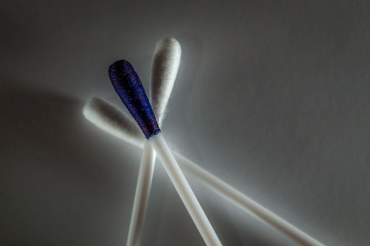 Close-up of cotton swab on table