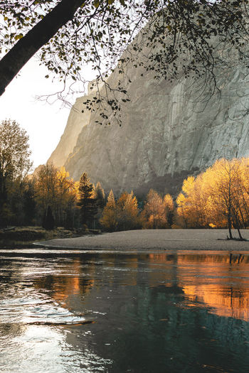 Scenic mountain region comprising the Sierra Nevada Range & Yosemite Valley of the Merced river; famous for giant sequoias, huge rock domes & peaks. Yosemite National Park Animal Themes Beauty In Nature Day Fall Fall Colors Foliage Growth Lake Nature No People Outdoors Reflection Reflection Lake Scenics Sky Sunset Tree Water