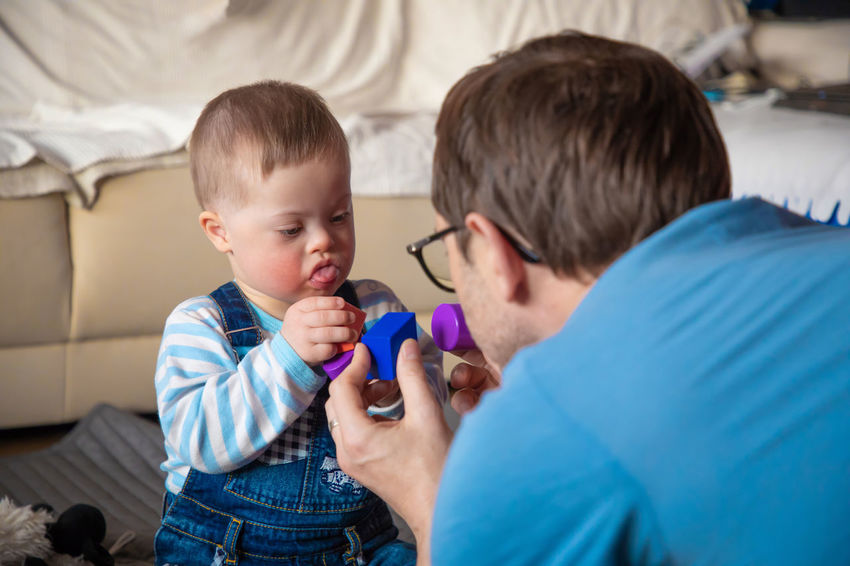 Babyboy Adult Bed Bedroom Boys Care Casual Clothing Child Childhood Down Syndrome Headshot Healthcare And Medicine Holding Human Body Part Indoors  Innocence Males  Men Mental Health  Offspring Real People Son Togetherness Two People