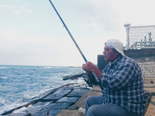 Only Men One Man Only Sea One Person Relaxation Adult People Outdoors Leisure Activity Day Sky People And Places People Of EyeEm EyeMeCapture VSCO Cooph Vscodaily Fishing Fishing Port Fishing Time Fisherman Alexandria Egypt Alexandria My Year My View Travel Destinations