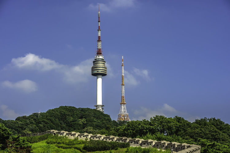 Seoul tower,Namsan tower in korea Architecture Building Exterior Built Structure Cloud - Sky Communication Day Global Communications Nature No People Outdoors Plant Sky Spire  Tall - High Technology Tourism Tower Travel Travel Destinations Tree