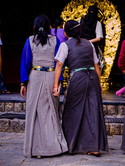 Buddhist Temple Casual Clothing City Life Cultures Day Full Length Himachalpradesh India Leisure Activity Lifestyles Medium Group Of People Men Outdoors Tibetan  Tourism Traditional Clothing Women Who Inspire You