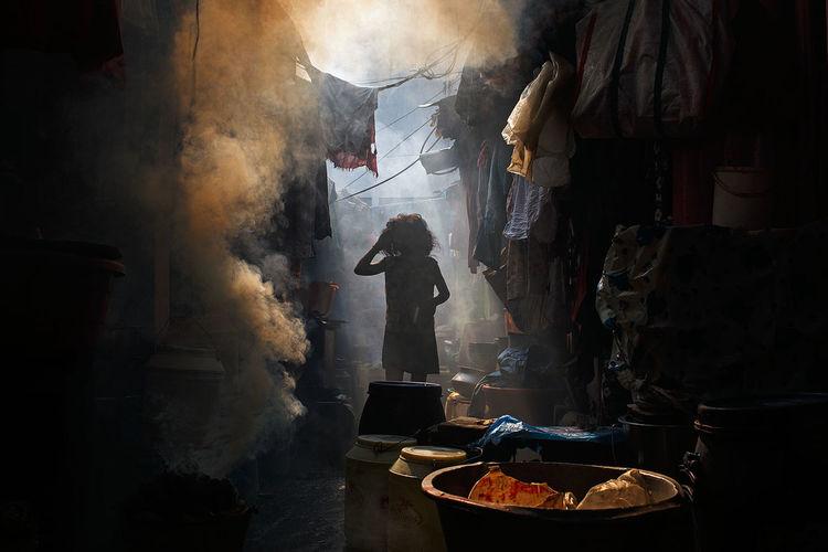 A smoky alleyway hidden somewhere in Central Kolkata, India. People Documentary Street Photography India Kolkata Documentary Photography ASIA Travel Travel Photography Streetphotography Young Girl Light The Street Photographer - 2017 EyeEm Awards