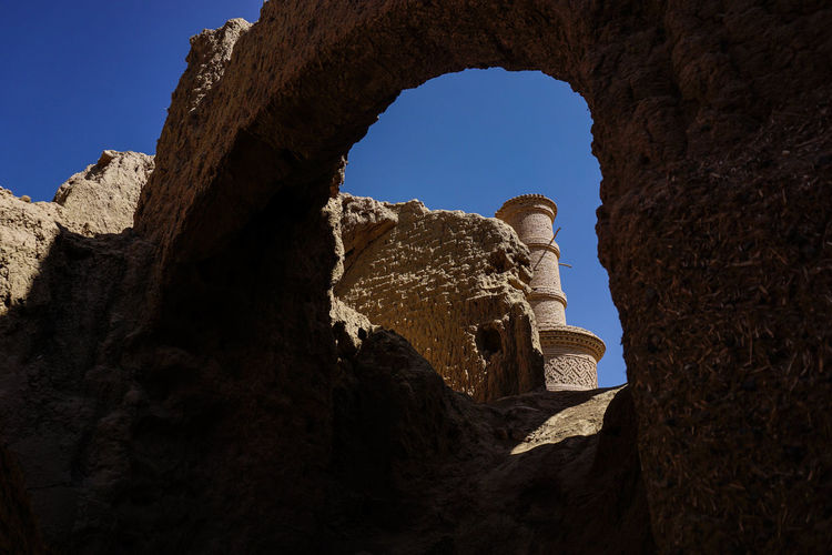 Travel Destinations Travel Photography Iran Persian Architecture Islamic Architecture Shia Community Sky History Clear Sky The Past Rock - Object Rock Formation Old Ruin Low Angle View Ancient Day Arch Sunlight Old Abandoned Ruined Outdoors Ancient Civilization Archaeology