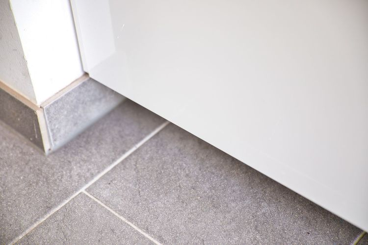 High angle view of tiled floor against wall at home