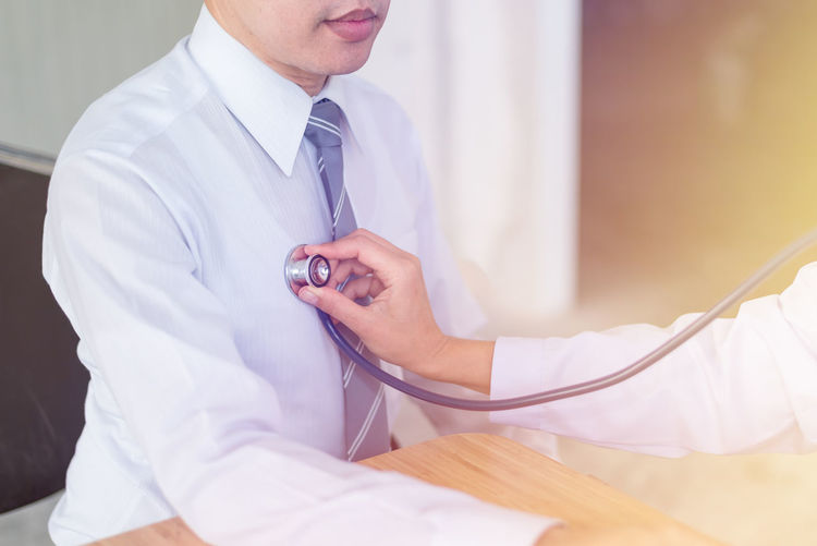 Care Close-up Day Doctor  Expertise Healthcare And Medicine Hospital Human Body Part Human Hand Indoors  Lab Coat Medical Clinic Medical Exam Medical Occupation Men Occupation Patient People Real People Sitting Stethoscope  Two People Working Young Adult