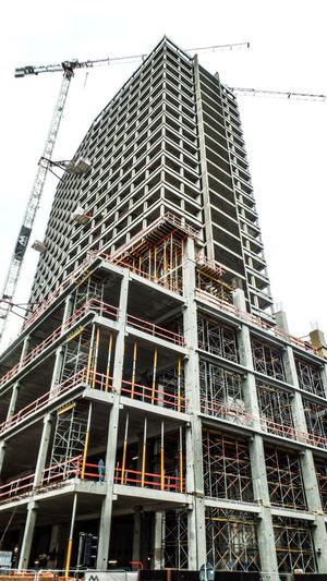 Built Structure Building Exterior Architecture Low Angle View Construction Site Building Industry Construction Industry No People Sky Development Incomplete Day Outdoors Crane - Construction Machinery Machinery Scaffolding Nature City Modern Office Building Exterior Construction Equipment Apartment