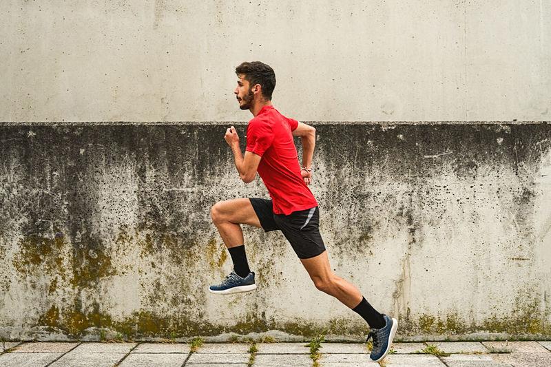Full length of man running on wall