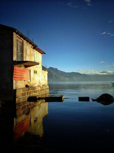 Lago De Atitlan Atitlan Lake Blue Sky Old House Water Reflections Lake View Guatemala Sunrise Photography Sunrise And Sunsets