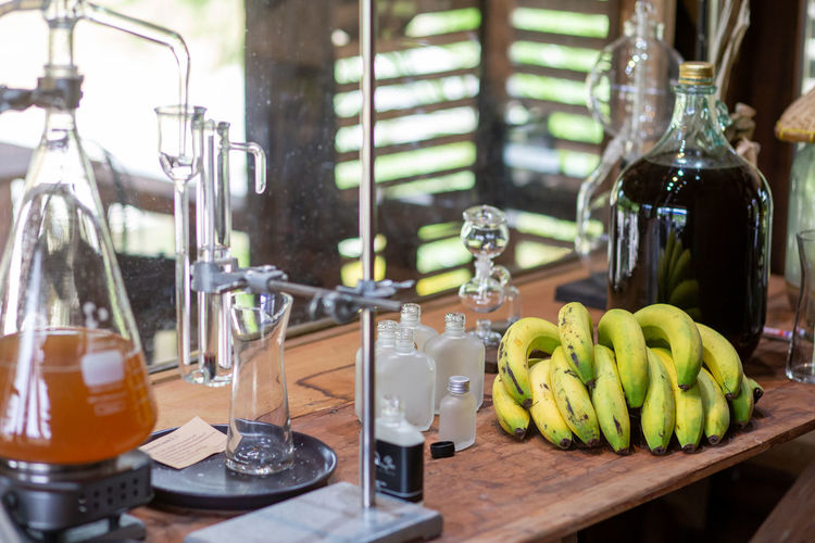 Fruits in glass container on table