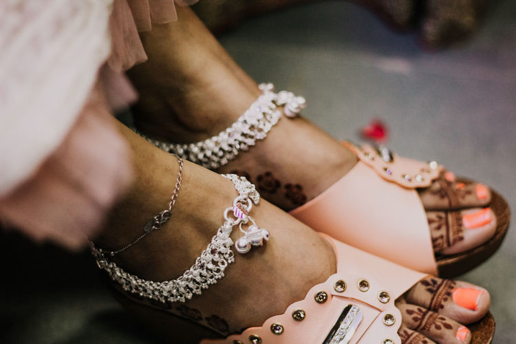 Low section of bride wearing anklets