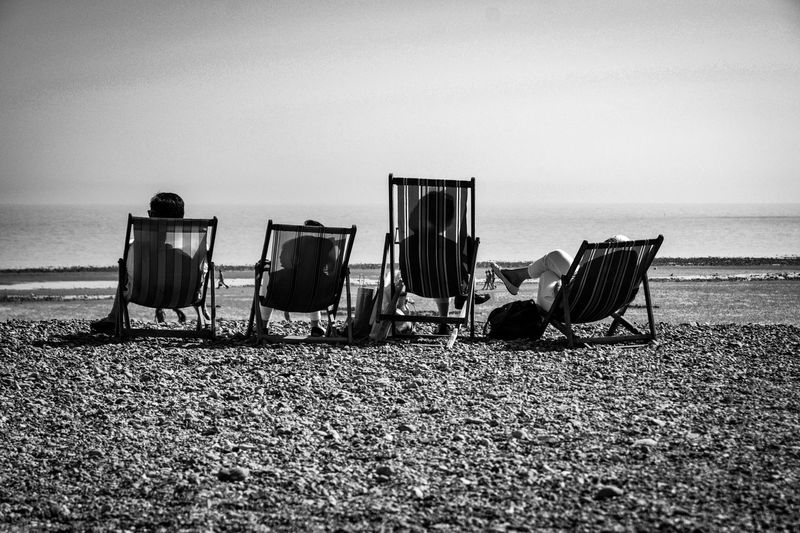 Sussex and Chill - B&W Black And White Photography Blackandwhite Deck Chairs Deck Chairs In A Row Deck Chair Family Worthing Beach Worthing Sussex Coast Sussex Beach Land Water Sea Sky Nature Sand Tranquility Beauty In Nature Day Outdoors Tranquil Scene Seat Chair