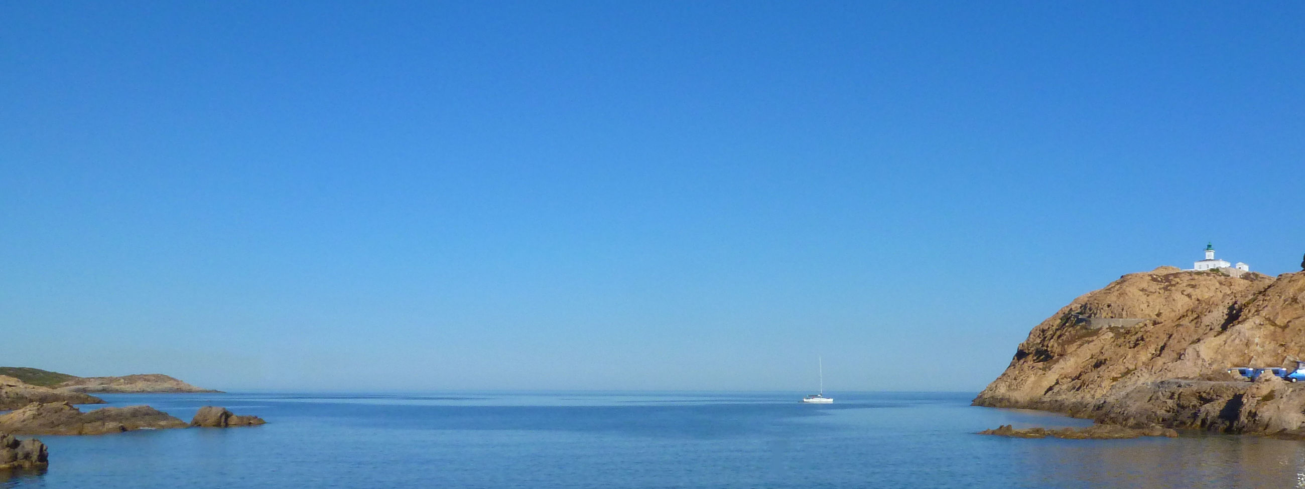 sea, water, clear sky, copy space, tranquil scene, tranquility, horizon over water, blue, scenics, beauty in nature, nature, rock - object, cliff, rock formation, waterfront, idyllic, rock, calm, remote, nautical vessel