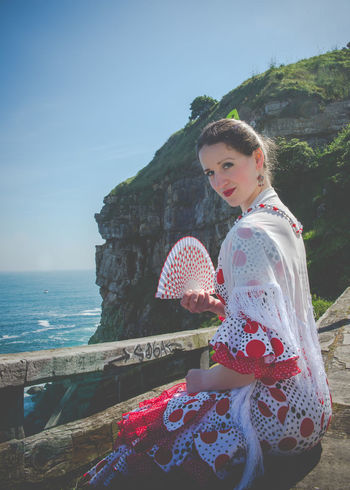 Andalucía Flamenco Spanish Woman Beauty In Nature Clear Sky Day Leisure Activity Lifestyles Looking At Camera Mountain Nature One Person Outdoors People Portrait Real People Retaining Wall Rock - Object Scenics Sea Sky Standing Tree Water Young Adult Young Women