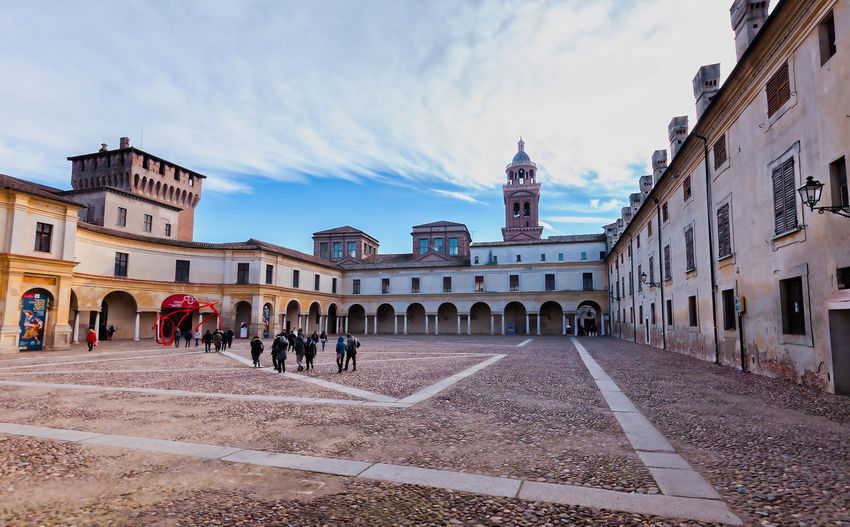 Mantua, Italy - January -4 -2019: European capital of culture and UNESCO world heritage site. Building Exterior Architecture Built Structure Sky Building City Cloud - Sky Group Of People Nature Real People Street Day Large Group Of People Transportation History Crowd The Past Arch Men Direction Outdoors Clock Mantua Italy