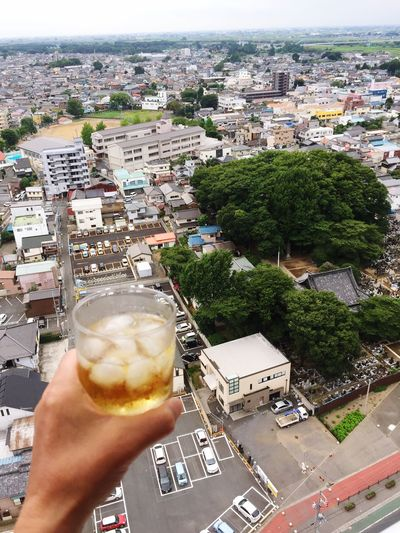 City Building Exterior Architecture Human Hand Built Structure Human Body Part Cityscape Personal Perspective Food And Drink City Life High Angle View One Person Day Real People Outdoors Holding Tree Town Drink Lifestyles Scotch Whisky Japan