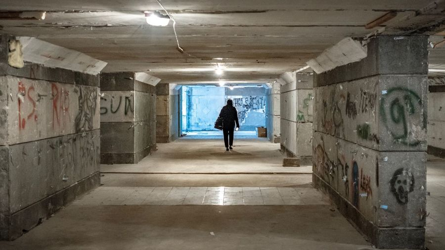 Renovation Into The Light Passage The Way Out Light At The End Of The Tunnel Subway Underpass Full Length Architecture The Way Forward One Person Direction Lifestyles Rear View Tunnel Real People Built Structure Walking Graffiti Women Wall - Building Feature Adult Illuminated Indoors  Transportation Ceiling