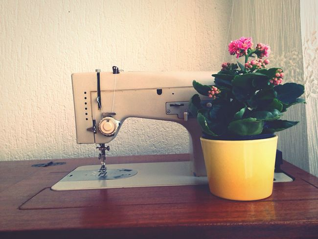 Old Sewing Machine And a Flower