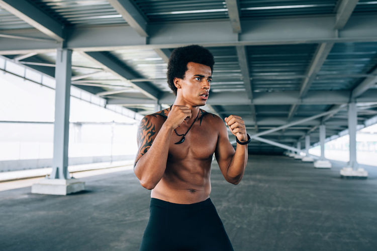Athlete Shadow Boxing Kickboxing Outdoors One Person Standing Lifestyles Sport Training Working Out Exercising Healthy Lifestyle Sports Training Strength Sports Clothing Vitality Punch African American Determination Bare Chest Sweat Muscular Build