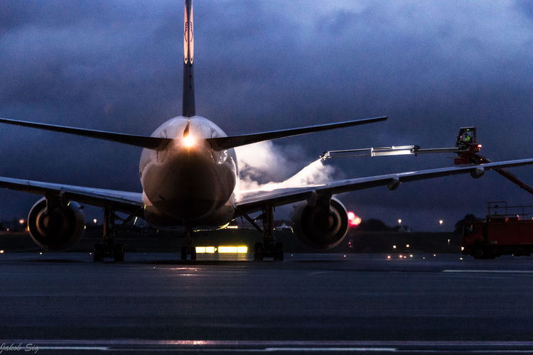 Deice is important over wintertime Transportation Airplane Travel Mode Of Transport Night Illuminated Air Vehicle Public Transportation Airport Runway Outdoors No People Journey Sky Commercial Airplane Locomotive Rampagent