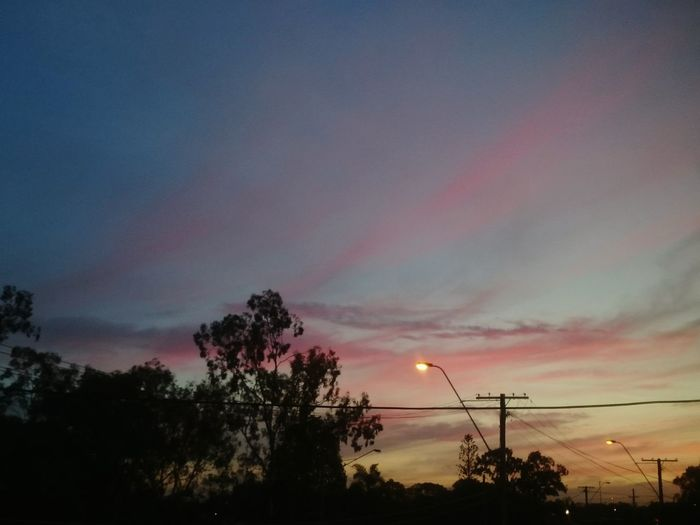 Sunset in the suburbs. Dramatic Sky Silhouette Sky No People Sunset Tranquility Scenics Beauty In Nature Outdoors Nature Twilight Street Lights Pink Clouds Gradiented Sky Gradient Nature Gradient Sky